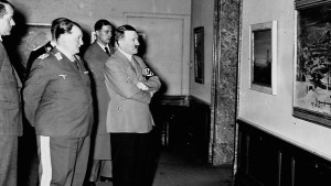 Hermann Goering and Adolf Hitler tour the artworks at the Degenerate Art exhibit. The Nazis staged the exhibition in a propaganda drive to demonstrate the moral and cultural decadence of Jewish and modernist artists.